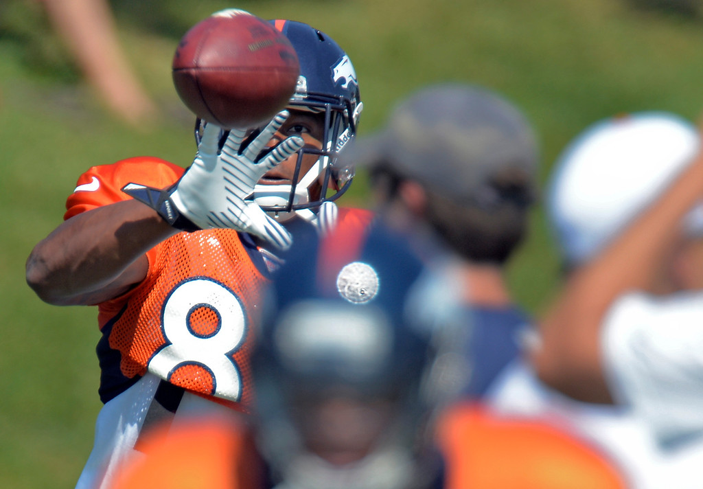 . Denver Broncos wide receiver Demaryius Thomas (88) has his eye on a pass during practice August 20, 2013 at Dove Valley (Photo by John Leyba/The Denver Post)