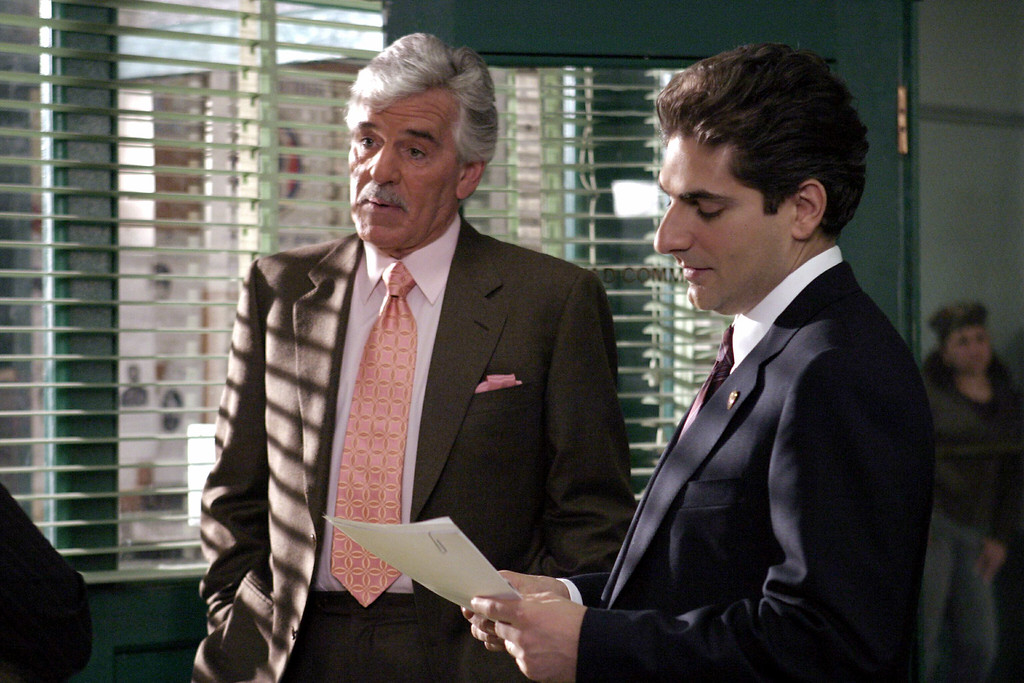 ". In this undated photo from NBC Universal,  Dennis Farina, who plays New York Police Detective Joe Fontana, acts in a scene with Michael Imperioli in the role of Detective Nick Falco, in an episode from NBC\'s police drama,""Law & Order.\"" Farina died suddenly on Monday, July 22, 2013, in  Scottsdale, Ariz., after suffering a blood clot in his lung. He was 69. (AP Photo/ NBC Universal,Jessica Burstein)"
