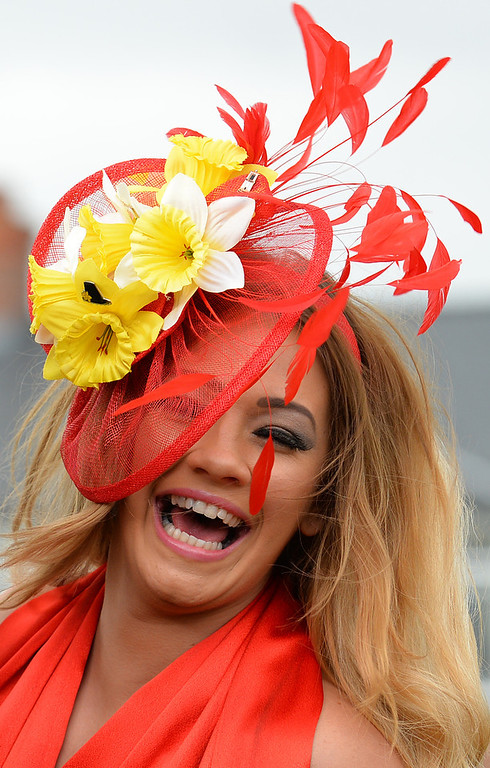 . A racegoer poses for photographers as they attend Ladies Day, the second day of the Grand National Meeting horse racing event at Aintree Racecourse in Liverpool, north-west England on April 5, 2013. The annual three day meeting culminates in the Grand National which is run over a distance of four miles and four furlongs (7,242 metres), and is the biggest betting race in the United Kingdom.  ANDREW YATES/AFP/Getty Images