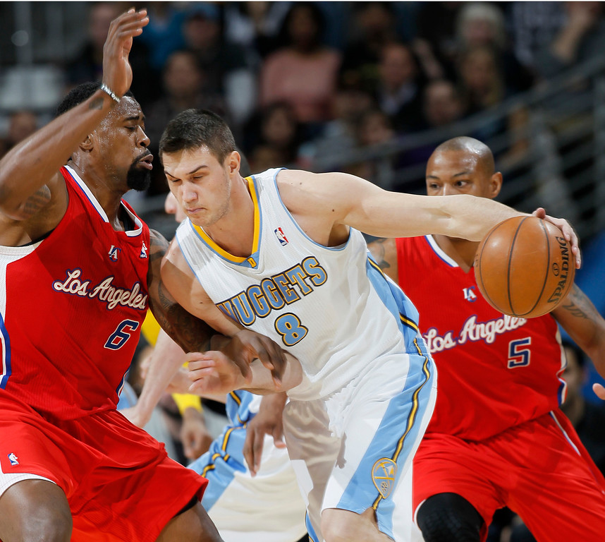 . Denver Nuggets forward Danilo Gallinari, right, of Italy, works the ball inside against Los Angeles Clippers center DeAndre Jordan in the first quarter of  an NBA basketball game in Denver, Thursday, March 7, 2013. (AP Photo/David Zalubowski)