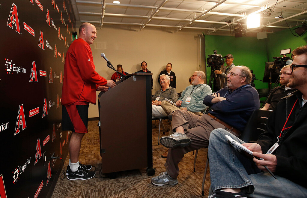 . Arizona Diamondbacks manager Kirk Gibson, left, addresses the media a day before pitchers and catchers have their first MLB spring training baseball practice at the Diamondbacks training facility, Thursday, Feb. 6, 2014, in Scottsdale, Ariz. (AP Photo/Ross D. Franklin)