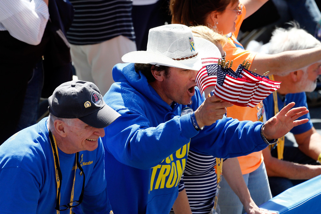 . First responder Carlos Arredondo cheers on finishers of the 118th Boston Marathon on April 21, 2014 in Boston, Massachusetts.  (Photo by Jim Rogash/Getty Images)