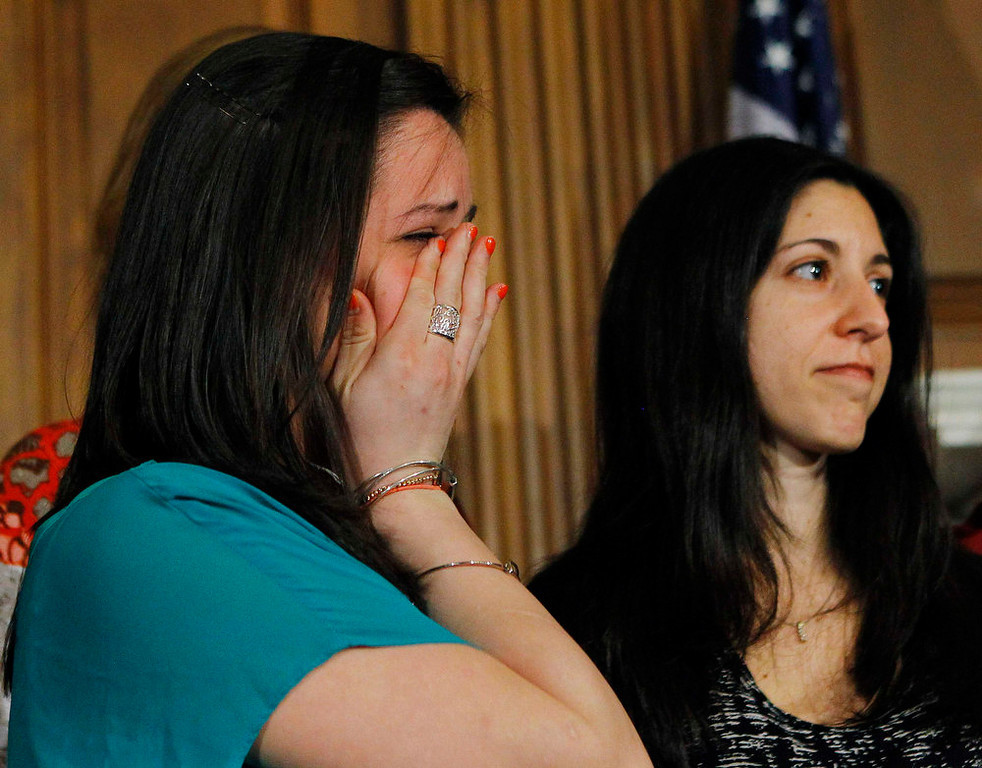 . Jillian Soto (L) cries next to Miya Rahamim (R) during a news conference for family members of gun violence victims in Washington April 11, 2013. Soto\'s sister Victoria, was a first grade teacher at Sandy Hook Elementary School who was killed in last December\'s massacre, while Rahamim\'s father was killed in a workplace shooting. The U.S. Senate cleared the way on Thursday for an emotional, weeks-long debate on proposals to curb gun violence, rejecting an effort by conservative Republicans to block consideration of gun-control legislation prompted by December\'s Newtown school massacre. REUTERS/Gary Cameron