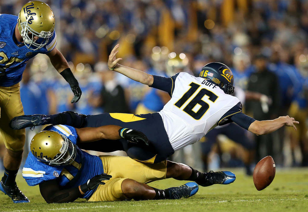 . Linebacker Anthony Barr #11 of the UCLA Bruins sacks quarterback Jared Goff #16 of the California Golden Bears at the Rose Bowl on October 12, 2013 in Pasadena, California. Goff lost the ball on the play but Cal recovered.  (Photo by Stephen Dunn/Getty Images)