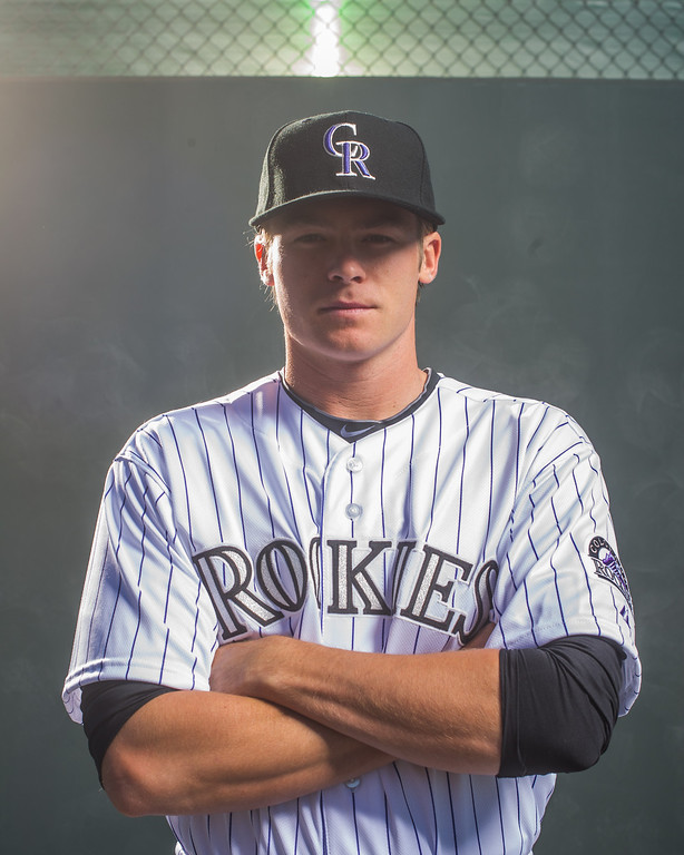 . Josh Rutledge #14 of the Colorado Rockies poses for a portrait at the Salt River Fields at Talking Stick on February 26, 2014 in Goodyear, Arizona. (Photo by Rob Tringali/Getty Images)
