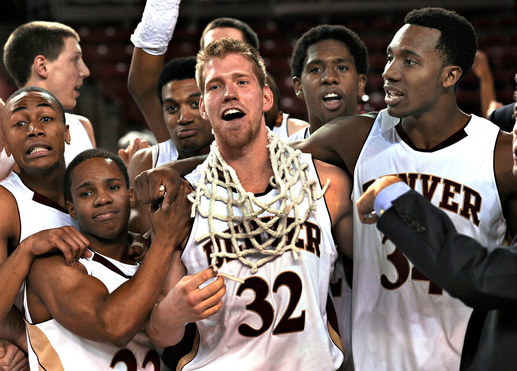 . Denver senior Chase Hallam wore the net around his neck at the end of the game. The University of Denver men\'s basketball team defeated the Louisiana Tech Bulldogs 78-54 at Magness Arena Saturday night, March 9, 2013. (Photo By Karl Gehring/The Denver Post)