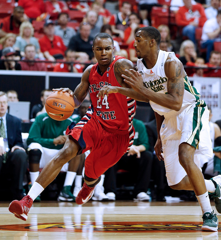 . Fresno State\'s Kevin Foster drives past Colorado State\'s Greg Smith during the first half of a Mountain West Conference tournament NCAA college basketball game on Wednesday, March 13, 2013, in Las Vegas. (AP Photo/Isaac Brekken)