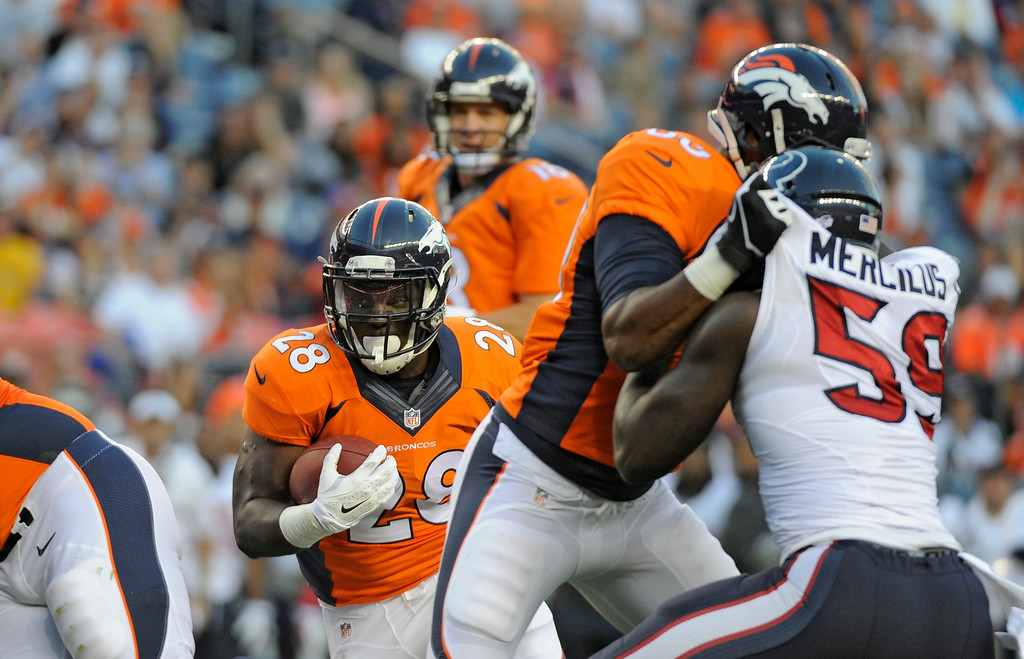 . DENVER, CO - AUGUST 23: Denver Broncos running back Montee Ball (28) finds a hole in the Houston Texans defense during the first quarter August 23, 2014 at Sports Authority Field at Mile High Stadium. (Photo by John Leyba/The Denver Post)