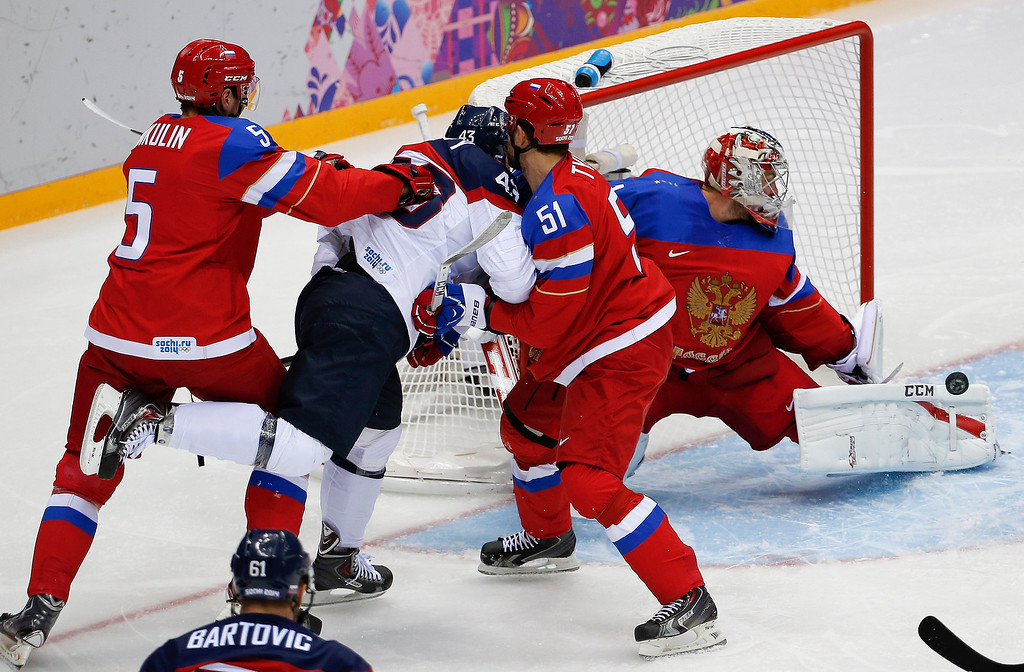 . Russia goaltender Semyon Varlamov blocks a shot by Slovakia in the first period of a men\'s ice hockey game at the 2014 Winter Olympics, Sunday, Feb. 16, 2014, in Sochi, Russia. (AP Photo/Julio Cortez)