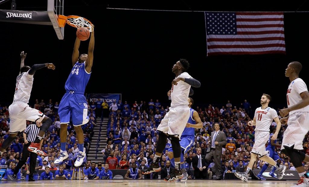 . Kentucky\'s Dakari Johnson (44) dunks during the second half of an NCAA Midwest Regional semifinal college basketball tournament game against the Louisville Friday, March 28, 2014, in Indianapolis. (AP Photo/David J. Phillip)