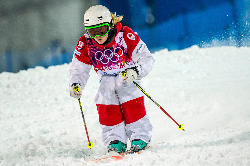 . KRASNAYA POLYANA, RUSSIA  - JANUARY 8: Justine Dufour-Lapointe, of Canada, competes in the Ladies\' Moguls Finals at Rosa Khutor Extreme Park during the 2014 Sochi Olympic Games Saturday February 8, 2014. Justine Dufour-Lapointe won gold with a score of 22.44. Her sister Chloe Dufour-Lapointe won the silver with a score of 21.66. Hannah Kearney, of USA, won bronze with a score of 21.49. (Photo by Chris Detrick/The Salt Lake Tribune)