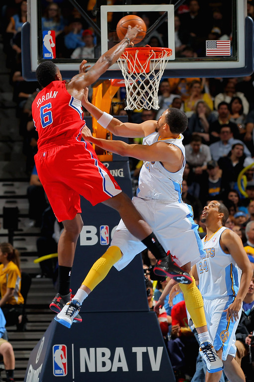 . DENVER, CO - MARCH 07:  DeAndre Jordan #6 of the Los Angeles Clippers is fouled by JaVale McGee #34 of the Denver Nuggets as he takes a shot at the Pepsi Center on March 7, 2013 in Denver, Colorado.  (Photo by Doug Pensinger/Getty Images)
