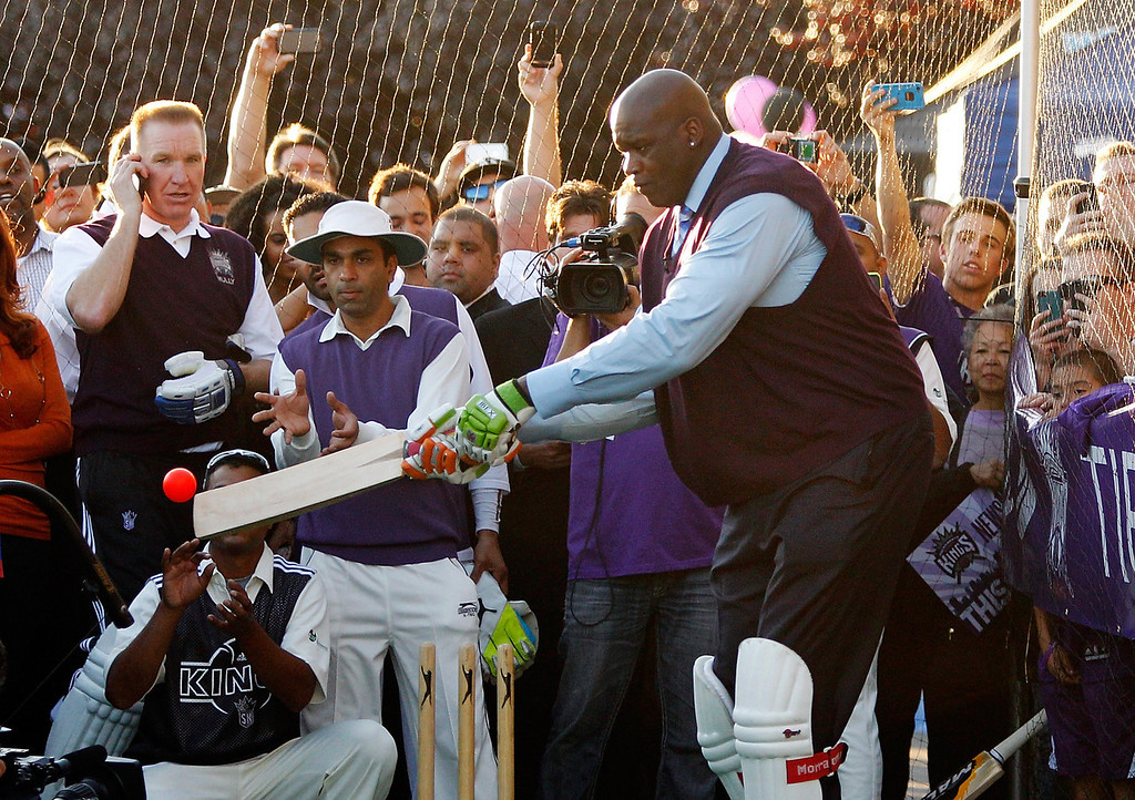 . Sacramento Kings minority owner Shaquille O\'Neal participates in a cricket demonstration before the start of an NBA basketball game between the Denver Nuggets and the Sacramento Kings, Wednesday, Oct. 30, 2013, in Sacramento. (AP Photo/Genevieve Ross)