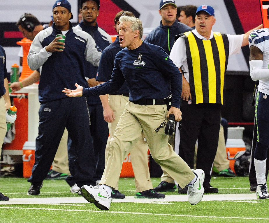 . Head Coach Pete Carroll of the Seattle Seahawks disputes a call by an official during the game against the Atlanta Falcons at the Georgia Dome on November 10, 2013 in Atlanta, Georgia. (Photo by Scott Cunningham/Getty Images)