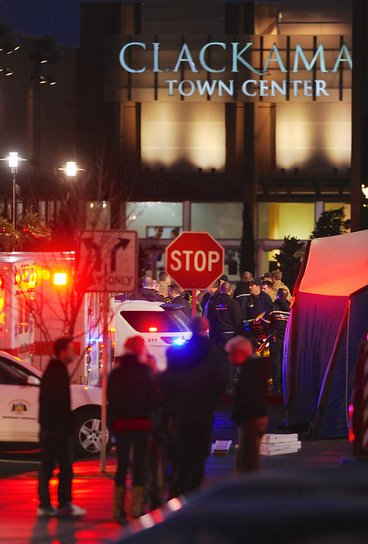 . Police and medics outside the scene of a multiple shooting at Clackamas Town Center Mall in Clackamas, Ore., Tuesday Dec. 11, 2012. A gunman is dead after opening fire in the Portland, Ore., area shopping mall Tuesday, killing two people and wounding another, sheriff\'s deputies said. (AP Photo/Greg Wahl-Stephens)
