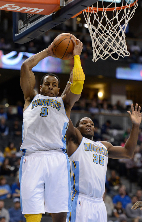 . DENVER, CO. - JANUARY 28: Denver Nuggets shooting guard Andre Iguodala (9) hauls down a defensive rebound during the first quarter against the Indiana Pacers  January 28, 2013 at Pepsi Center. The Denver Nuggets host the Indiana Pacers in NBA action. (Photo By John Leyba / The Denver Post)
