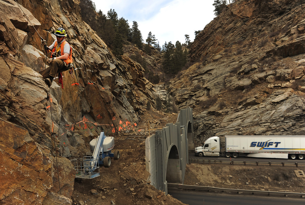 . IDAHO SPRINGS, CO- MARCH 28:  Todd Hansen, Geotechnical/geological engineer for Yeh and Associates, Inc. inspects the rock above the twin tunnels on the east side.  Crews will be widening the east bound tunnel, so Hansen needs to design placements to put in reinforcement bolts to keep the rocks from falling once they begin work on blasting the rock to make the new tunnel.   Construction continues on road work on I-70 and the twin tunnels near Idaho Springs on March 28th, 2013.  The highway is being widened in the east bound lanes.  The widening will start just west of the twin tunnels after Idaho Springs and will continue until the exit for Highway 6 where I-70 becomes three lanes.  They expect the project to be finished by the end of 2013.  (Photo By Helen H. Richardson/ The Denver Post)