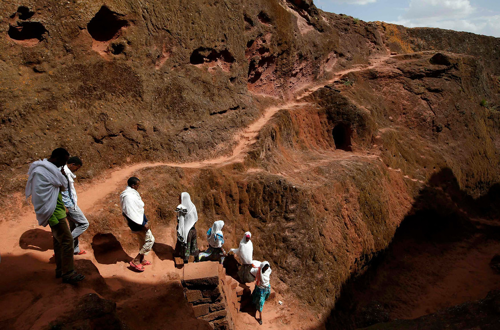 . Orthodox Christians walk outside the famous monolithic rock-cut churches during a Good Friday celebration in Lalibela May 3, 2013,  REUTERS/Goran Tomasevic