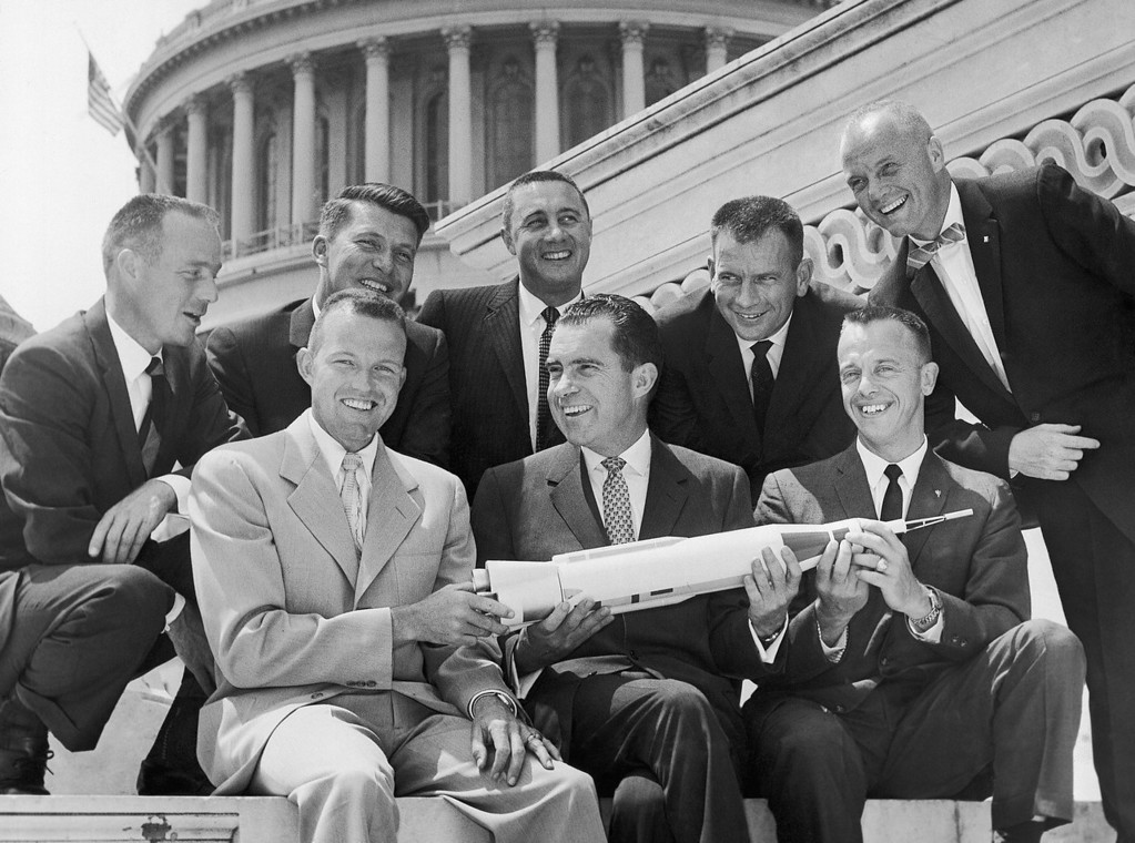 . Vice President Richard Nixon poses on Capitol steps in Washington, May 28, 1959 with seven astronauts who are undergoing training for space flight. From left, front row: Leroy Gordon Cooper, Nixon; and Alan Bartlett Shepard; rear row: Malcolm Scott Carpenter; Waller Marty Schirra Jr; Virgil Ivan Grissom; Donald Kent Slayton, and John Herschel Glenn, standing. They are posing with a model of a rocket. (AP Photo)