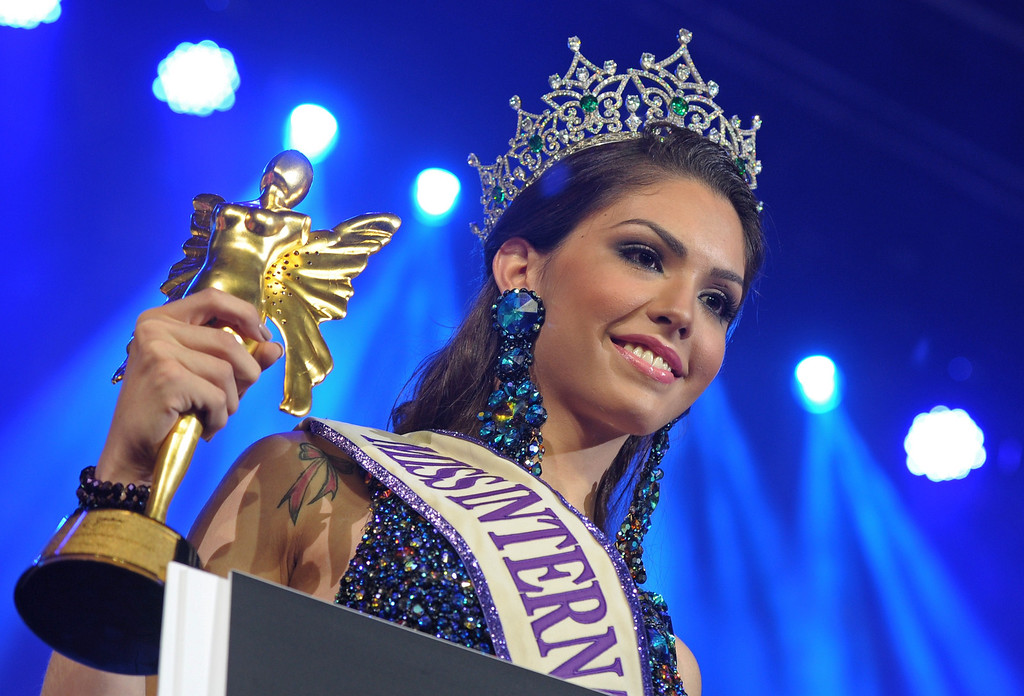 . Marcelo Ohio of Brazil celebrate with the trophy after winning the International Queen 2013 Transexual beauty contest in Pattaya on November 1, 2013. Twenty-five contestants from 17 countries competed in Pattaya for the Miss International Queen title.        AFP PHOTO / PORNCHAI KITTIWONGSAKUL/AFP/Getty Images
