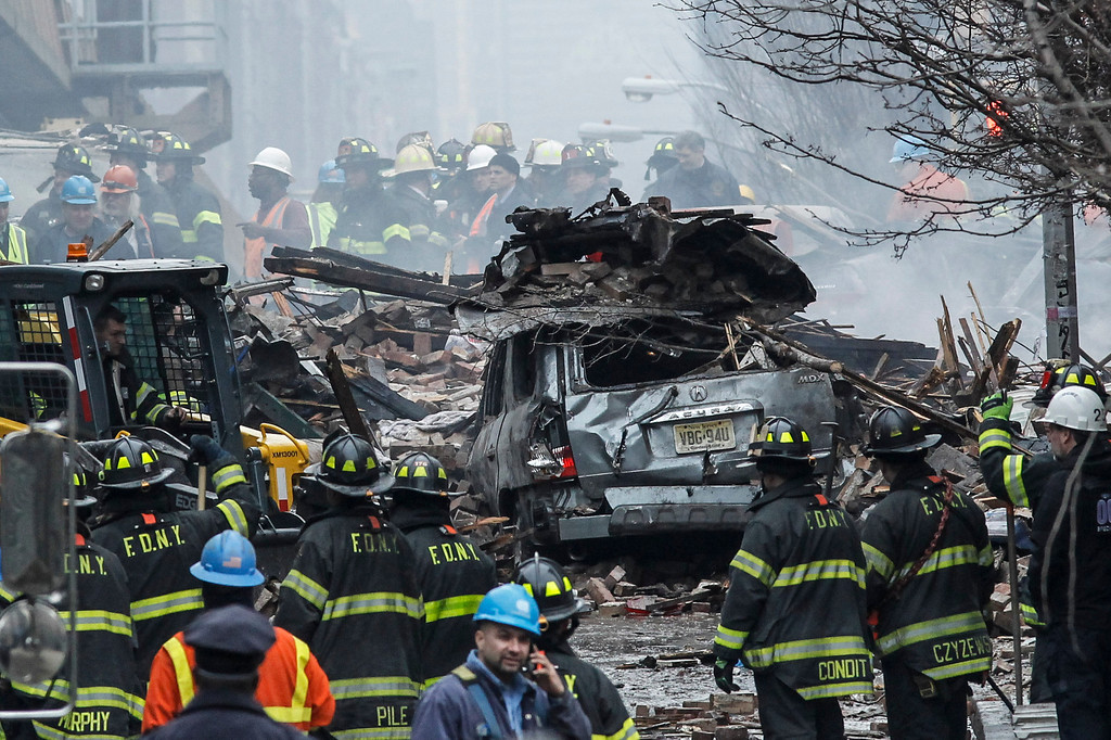 . Firefighters from the Fire Department of New York (FDNY) respond to a five-alarm fire and building collapse at 1646 Park Ave in the Harlem neighborhood of Manhattan March 12, 2014 in New York City.   (Photo by Kena Betancur/Getty Images)