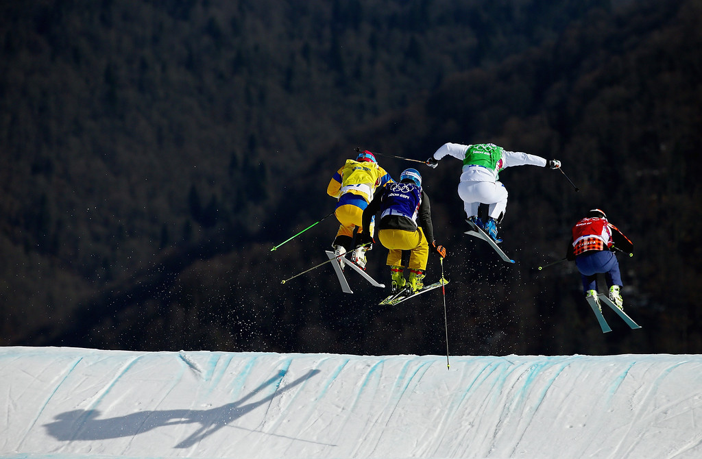 . Brady Leman (R) of Canada, Arnaud Bovolenta (2ndR) of France, Thomas Fischer of Germany and John Eklund (L) of Sweden compete during the Freestyle Skiing Men\'s Ski Cross Quarter Finals on day 13 of the 2014 Sochi Winter Olympic at Rosa Khutor Extreme Park on February 20, 2014 in Sochi, Russia.  (Photo by Al Bello/Getty Images)
