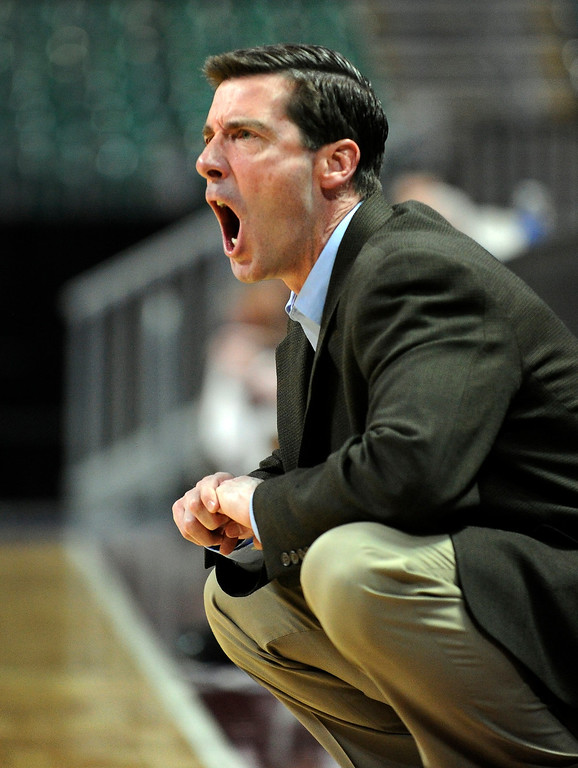 . Denver coach Joe Scott yells at his team during the fist half of a Western Athletic Conference tournament NCAA college basketball game against Texas State, Thursday, March 14, 2013, in Las Vegas. Texas State won 72-68. (AP Photo/David Becker)