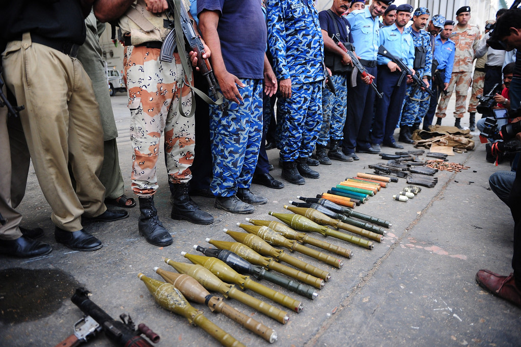 . Pakistani policemen show seized weapons after militants attacked Jinnah International Airport in Karachi on June 9, 2014. Pakistan\'s security forces said on June 9 they have relaunched a military operation at Karachi airport as gunfire resumed several hours after they announced the end of a militant siege that left 24 dead. AFP PHOTO/Asif HASSAN/AFP/Getty Images