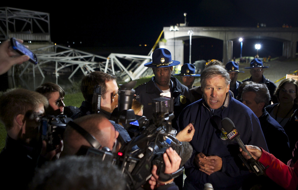 . MT. VERNON, WASHINGTON  - MAY 23: Washington State Governor Jay Inslee addresses the media at the scene of a bridge collapse into the Skagit River on Interstate 5 on May 23, 2013 near Mt. Vernon, Washington. People and cars were thrown into the river when the four-lane bridge collapsed. At least three people were rescued from the water but there have been no reported deaths. Police are investigating witnesses reports that a semi-truck may have struck the bridge causing the collapse. (Stephen Brashear/Getty Images)