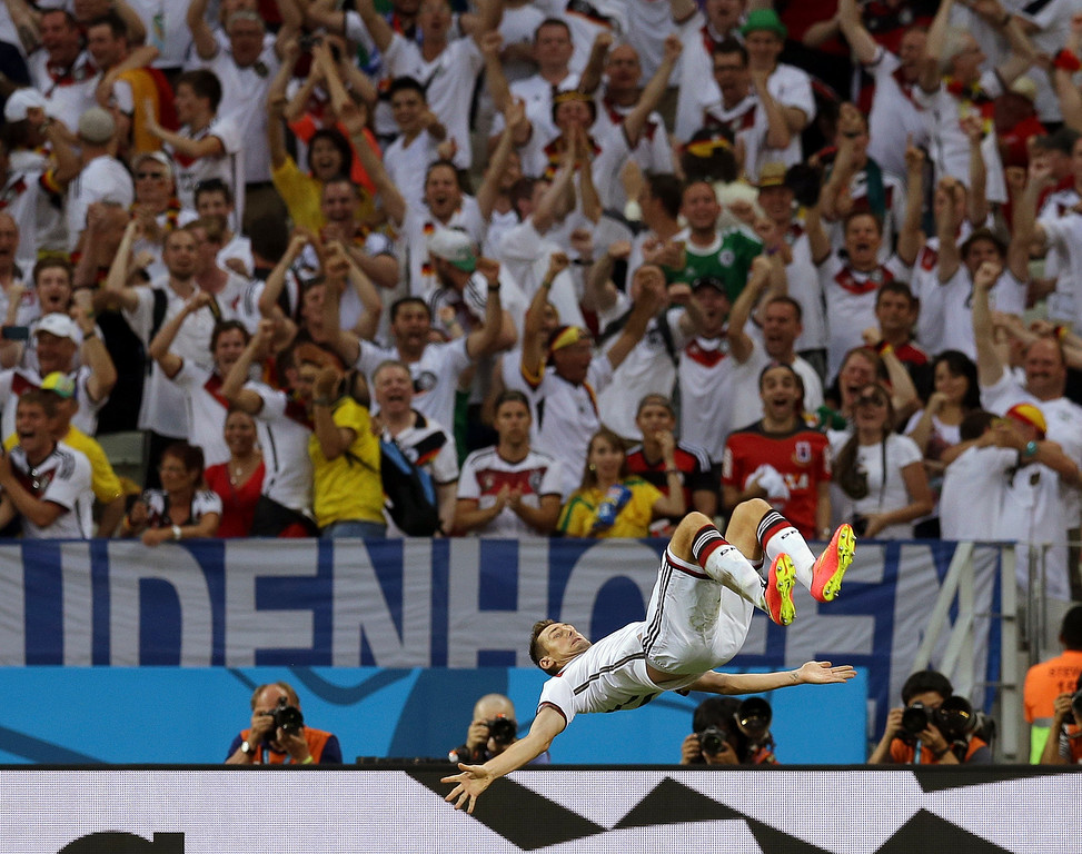 . Germany\'s Miroslav Klose does a somersault after scoring his side\'s second goal during the group G World Cup soccer match between Germany and Ghana at the Arena Castelao in Fortaleza, Brazil, Saturday, June 21, 2014. (AP Photo/Martin Mejia)