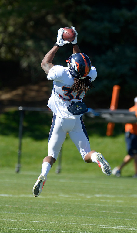 . Denver Broncos strong safety David Bruton (30) goes up for a pass during practice October 2, 2013 at Dove Valley. (Photo by John Leyba/The Denver Post)