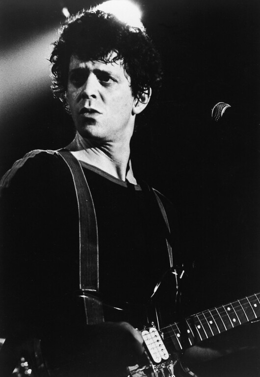 . Portrait of American rock and roll musician Lou Reed on stage with a guitar, 1970s. (Photo by Hulton Archive/Getty Images)