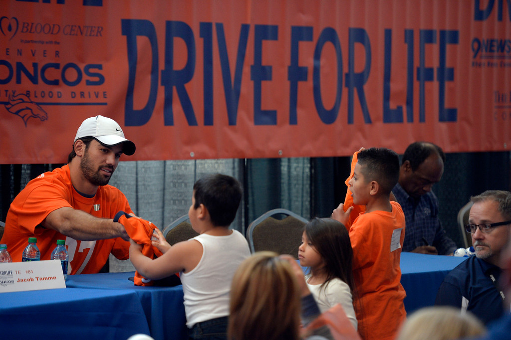 . DENVER, CO - OCTOBER 22: Denver Broncos WR Eric Decker signs autographs for fans as they attend The Denver Broncos and Bonfils Blood Center\'s 16th annual Drive for Life community blood drive October 22, 2013 at Sports Authority Field. (Photo by John Leyba/The Denver Post)