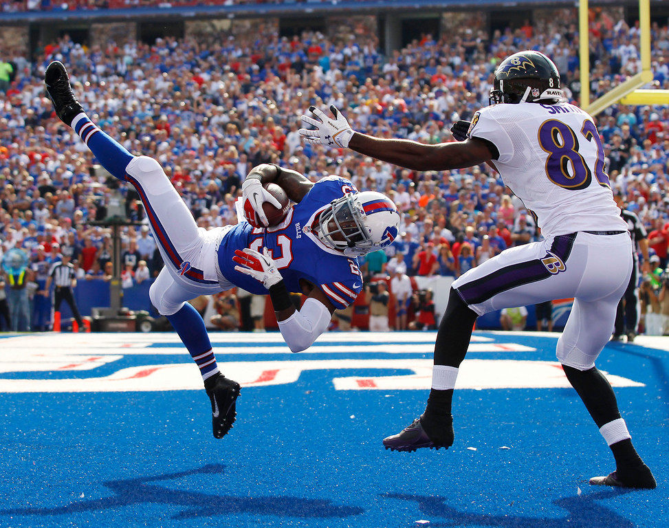 . Buffalo Bills free safety Aaron Williams (23) intercepts a pass intended for Baltimore Ravens wide receiver Torrey Smith (82) during the second half of an NFL football game on Sunday, Sept. 29, 2013, in Orchard Park, N.Y. (AP Photo/Bill Wippert)
