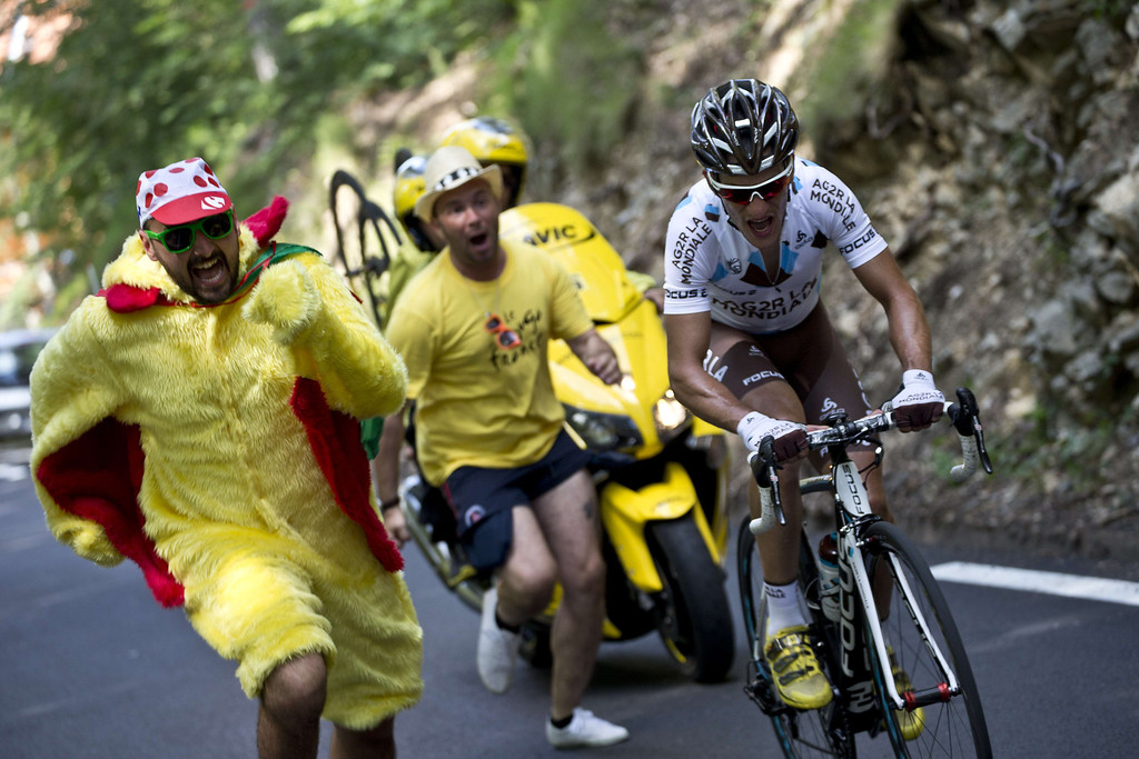 . France\'s Blel Kadri rides as fans run near him during the 156 km second stage of the 100th edition of the Tour de France cycling race on June 30, 2013 between Bastia and Ajaccio, on the French Mediterranean Island of Corsica.    JEFF PACHOUD/AFP/Getty Images