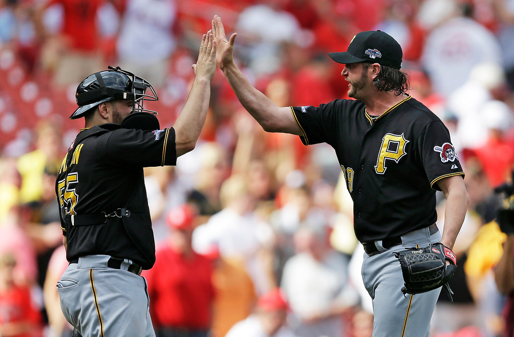 . Pittsburgh Pirates relief pitcher Jason Grilli, right, and catcher Russell Martin (55) celebrate after beating the St. Louis Cardinals 7-1 in Game 2 of baseball\'s National League division series on Friday, Oct. 4, 2013, in St. Louis. The best-of-five games series is tied 1-1.  (AP Photo/Jeff Roberson)