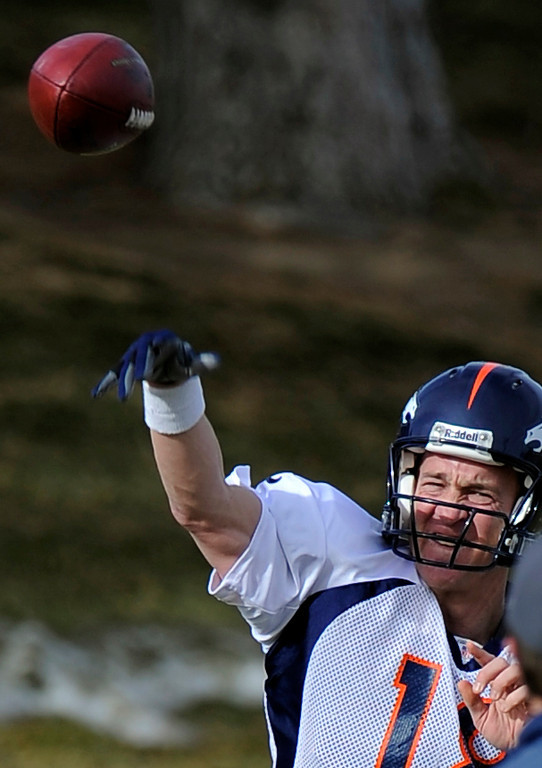 . Denver Broncos quarterback Peyton Manning (18) throws a pass during practice December 18, 2013 at Dove Valley (Photo by John Leyba/The Denver Post)