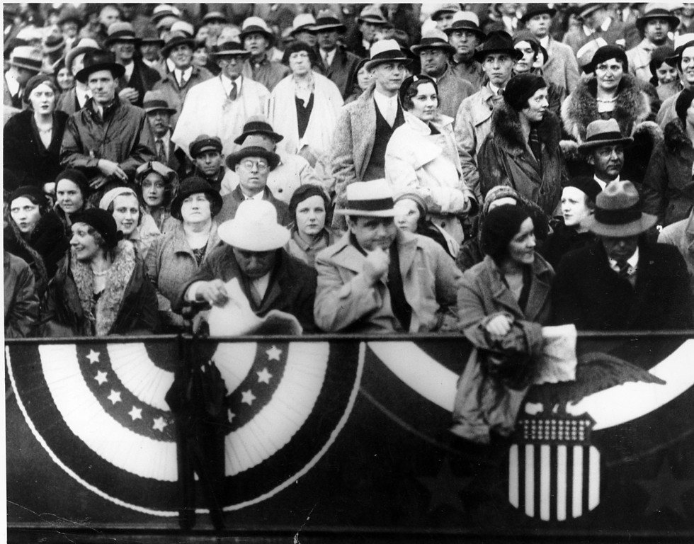 . Chicago mobster Al Capone is sitting with his hand to his chin as he watches the Notre Dame vs. Northwestern football game in Chicago on Oct. 9, 1931.  (AP Photo)