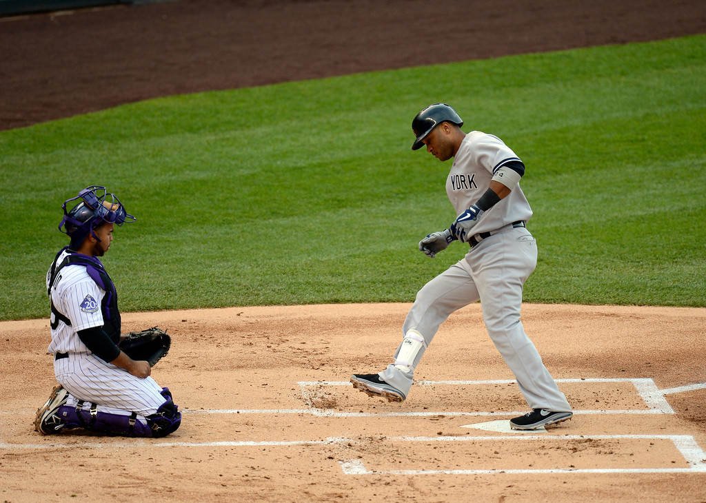 . Wilin Rosario (20) of the Colorado Rockies watches Robinson Cano (24) of the New York Yankees touch home plate his home run in the fifth inning off of Adam Ottavino (0) of the Colorado Rockies May 9, 2013 at Coors Field. (Photo By John Leyba/The Denver Post)