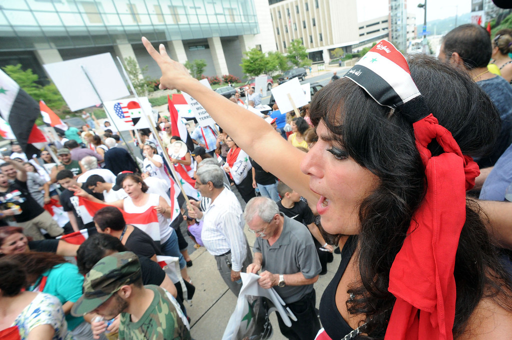 . Katya Saleet of Allentown joined the Syrian community protest against U.S. or NATO involvement in Syria\'s unrest Friday, Aug. 30, 2013, in Allentown, Pa. (AP Photo/ Express-Times, Sue Beyer)