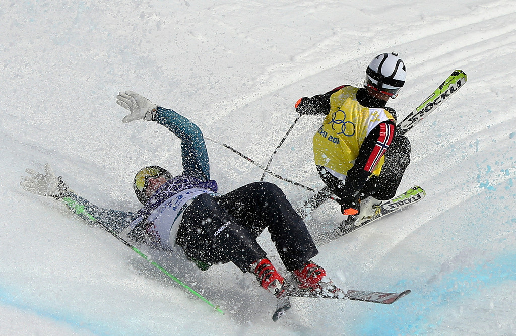 . Australia\'s Scott Kneller, left, and Norway\'s Thomas Borge Lie crash during a men\'s ski cross heat at the Rosa Khutor Extreme Park, at the 2014 Winter Olympics, Thursday, Feb. 20, 2014, in Krasnaya Polyana, Russia. (AP Photo/Sergei Grits)