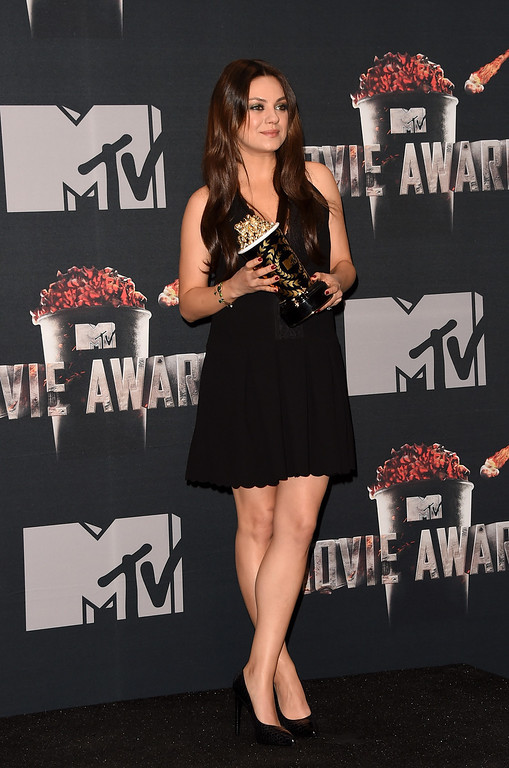 . Actress Mila Kunis poses with the Best Villain award for \'Oz The Great and Powerful\' in the press room during the 2014 MTV Movie Awards at Nokia Theatre L.A. Live on April 13, 2014 in Los Angeles, California.  (Photo by Jason Merritt/Getty Images for MTV)