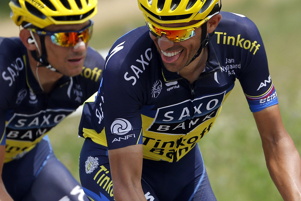 . Spain\'s Alberto Contador smiles as he rides with a teammate during the 242.5 km fifteenth stage of the 100th edition of the Tour de France cycling race on July 14, 2013 between Givors and Mont Ventoux, southeastern France.   JEFF PACHOUD/AFP/Getty Images