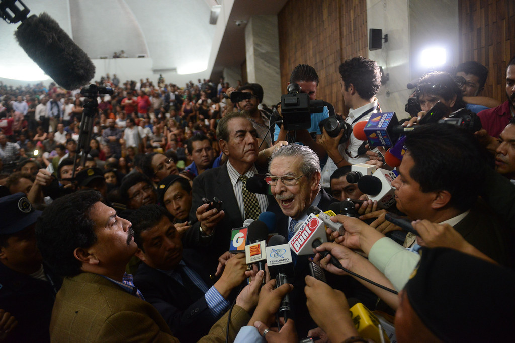 . Former Guatemalan de facto President (1982-1983), retired General Jose Efrain Rios Montt (C), 86, is hounded by the media after being sentenced on charges of genocide committed during his regime, in Guatemala City, on May 10, 2013. Rios Montt was found guilty of genocide and war crimes on Friday in a landmark ruling stemming from massacres of indigenous people in his country\'s long civil war. Rios Montt thus became the first Latin American convicted of trying to exterminate an entire group of people in a brief but particularly gruesome stretch of a war that started in 1960, lasted 36 years and left around 200,000 people dead or missing.  JOHAN ORDONEZ/AFP/Getty Images