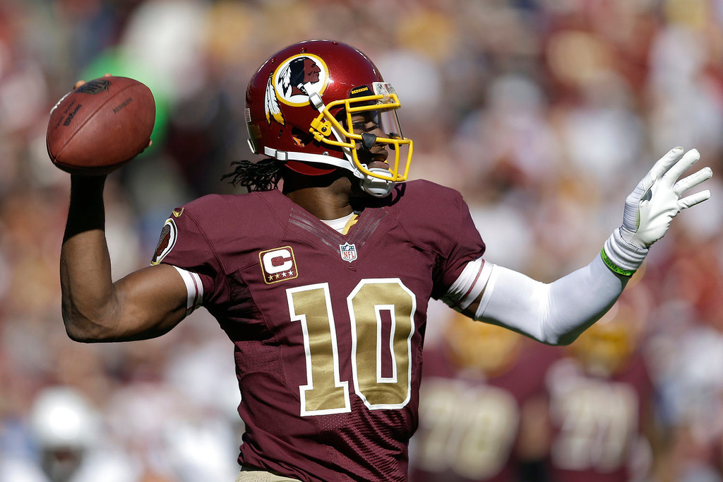 . Washington Redskins quarterback Robert Griffin III passes the ball during the first half of a NFL football game against San Diego Chargers in Landover, Md., Sunday, Nov. 3, 2013. (AP Photo/Patrick Semansky)