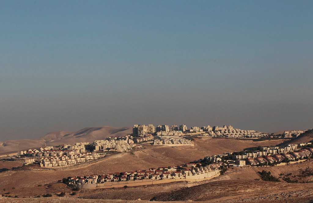 . A view of the West Bank Jewish settlement of Maale Adumim is seen near Jerusalem July 25, 2013. Israeli and Palestinian officials put forward clashing formats for peace talks due to resume in Washington on Monday for the first time in nearly three years after intense U.S. mediation. It is unclear how the United States hopes to bridge the core issues in the dispute, including borders, the future of Jewish settlements on the West Bank, the fate of Palestinian refugees and the status of Jerusalem. Picture taken July 25, 2013. REUTERS/Ammar Awad