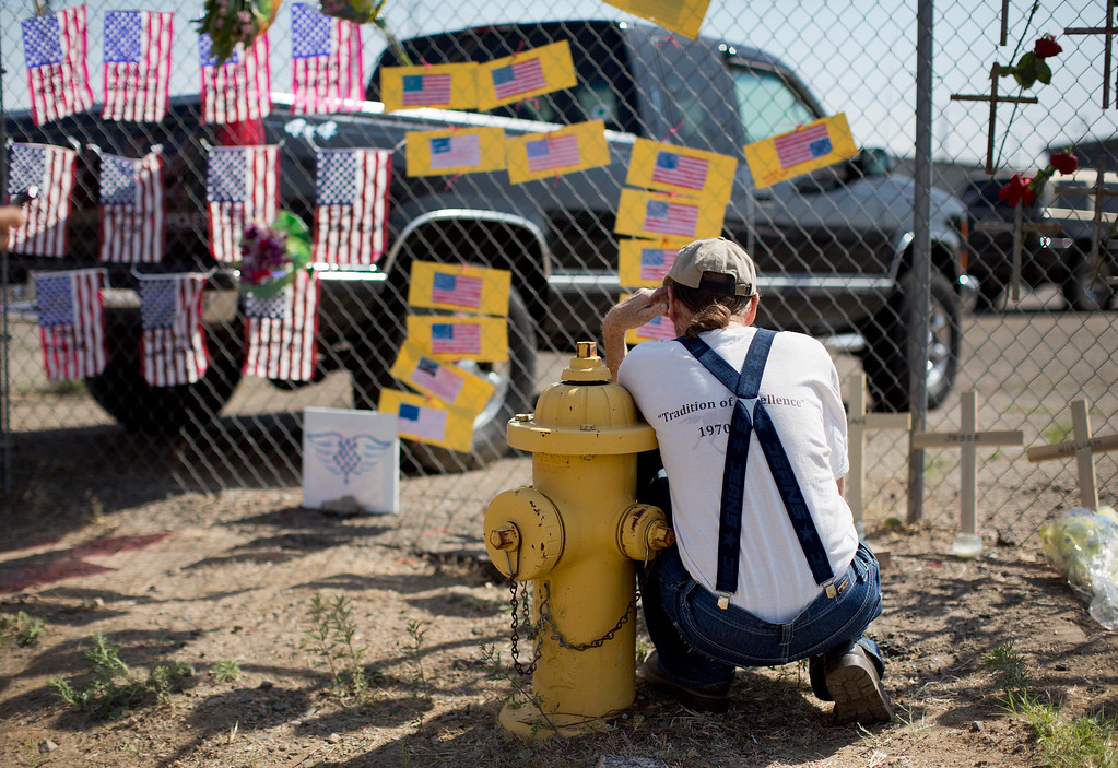. Stephen Grady reads various notes left at the Granite Mountain Interagency Hotshot Crew fire station, Tuesday, July 2, 2013 in Prescott, Ariz.  (AP Photo/Julie Jacobson)