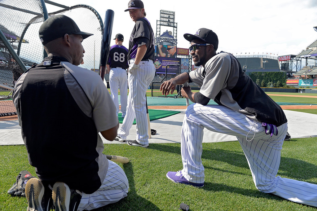 . Colorado Rockies Jonathan Herrera (L) talks with Dexter Fowler   during an open workout session for the fans July 18, 2013 at Coors Field. (Photo By John Leyba/The Denver Post)