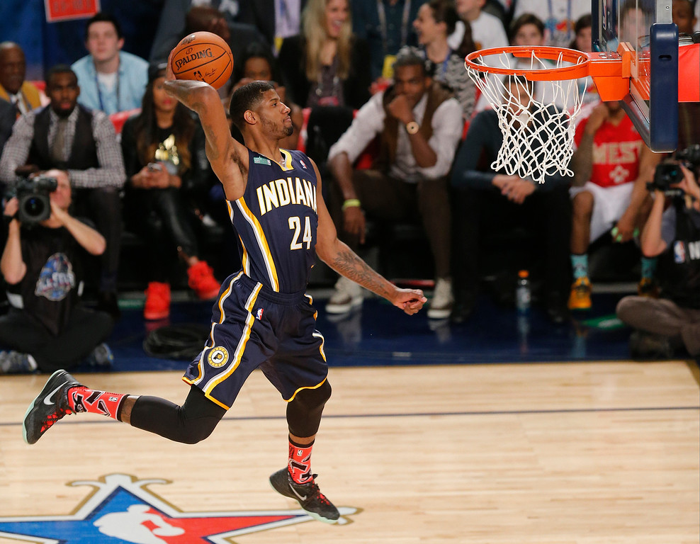 . Paul George of the Indiana Pacers participates in the slam dunk contest during the skills competition at the NBA All Star basketball game, Saturday, Feb. 15, 2014, in New Orleans. (AP Photo/Bill Haber)