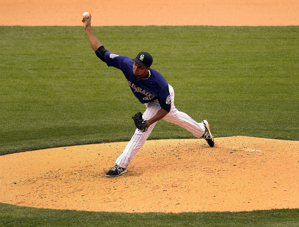 . Rockies starting pitcher Juan Nicasio delivered to the plate in the fourth inning. The Colorado Rockies hosted the New York Mets in a make up game Tuesday afternoon, April 16, 2013. Monday night\'s game was snowed out at Coors Field.  Photo By Karl Gehring/The Denver Post)